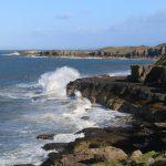 view of limestone coast near moelfre