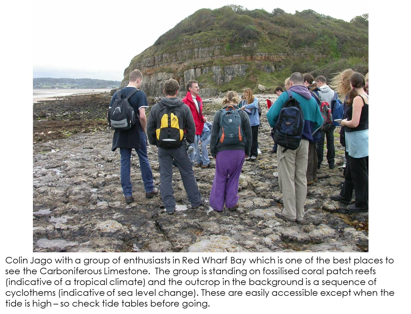 Colin Jago showing a group of people the geology at Red Wharf Bay