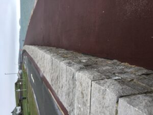 new limestone sea wall incorporating stainless steel flood gates